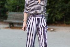 a work look with a striped shirt and pants, black heels and a statement bracelet by Olivia Palermo