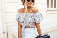 an off the shoulder striped crop top with a kno, high waisted jeans and a black bag