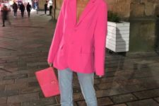 an oversized hot pink blazer, blue mom jeans, hot pink shoes and a small clutch