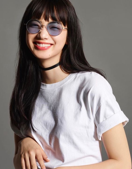 light blue oversized round sunglasses in a thin frame for a 90s inspired look
