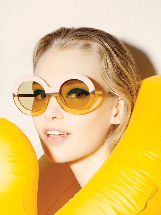 oversized retro-inspired round sunglasses in a thick colro block frame for a daring girl