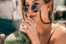 round sunglasses in a thin gold frame and with a lace, which is a trendy accessory