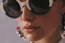 statement large and round sunglasses in black and white are an ultra modern and edgy accessory
