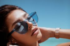 stylish pastel blue sheer sunglasses with no frame look very modern and very fresh