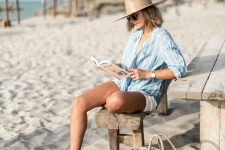 03 a beach look with an oversized striped shirt, white shorts, a straw hat and a straw bag plus brown leather slippers