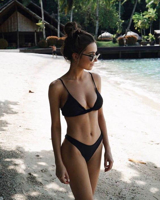 a black bikini with a high cut bottom is a stylish idea for a modern beach look