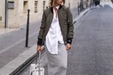 03 a minimalist fall look with an oversized white shirt, a grey midi skirt, black booties, a grey bomber jacket and a tote