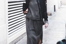 04 a grey sweatshirt and a matching midi skirt, black booties, a black bomber jacket and a clutch