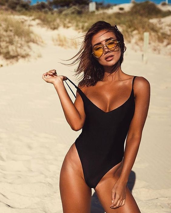 a black one piece swimsuit with a deep V neckline and high cut bottom is very sexy