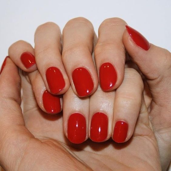 a classic red manicure is a bold and hot trend of 2020, classics never goes out of style