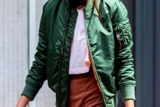 05 a white tee, a burnt orange skirt with a slit, a green bomber jacket for a bright fall outfit
