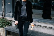 06 a monochromatic look with a grey top, black skinnies, a black velvet bomber jacket and booties