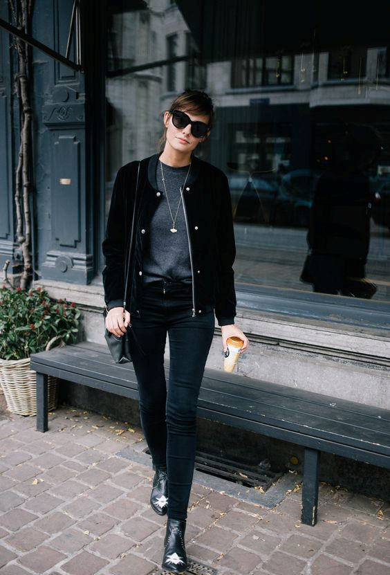 a monochromatic look with a grey top, black skinnies, a black velvet bomber jacket and booties