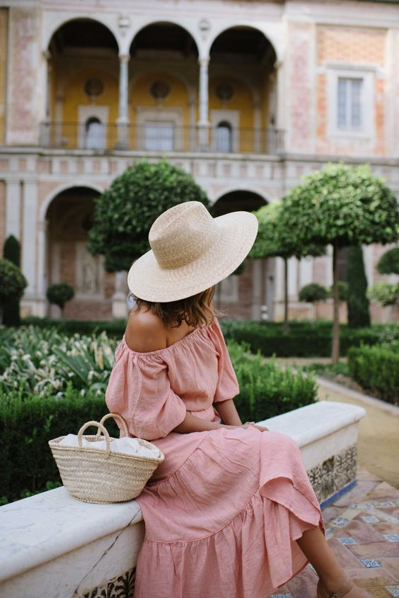a pink off the shoulder midi dress, a straw hat and a mini straw bag for a romantic summer look