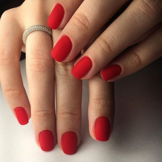 matte red nails are a hot and trnedy alternative to a usual red manicure