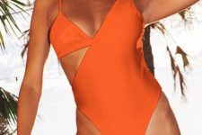 08 a bold and catchy orange one piece cutout swimsuit with a wide and a spaghetti strap and a deep neckline