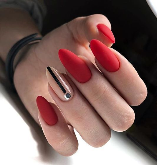 chic long oval nails in shiny red is a bold and trendy idea to rock