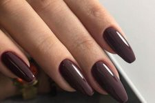 11 long chocolate brown nails of a coffin shape are a refined and stylish solution for now