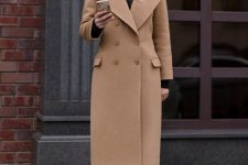 12 a simple fall look with a black turtleneck, navy jeans, tan booties, a camel coat is stylish