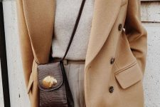13 a chic neutral fall look with a neutral turtleneck, pants, a camel double-breasted coat and a burgundy mini bag