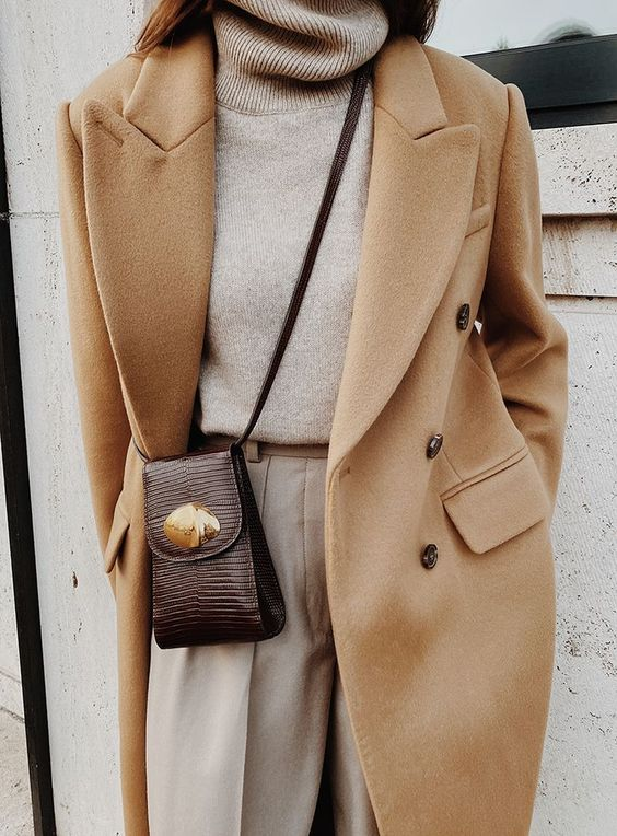 a chic neutral fall look with a neutral turtleneck, pants, a camel double breasted coat and a burgundy mini bag