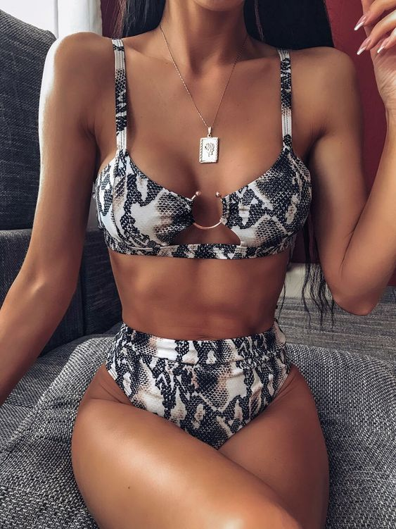 a trendy snake print bikini with a catchy top and a high waisted bottom