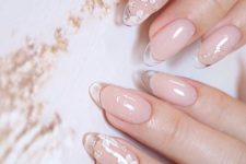 14 romantic nude nails with clear tips and accent floral nails with rhinestones are very chic