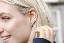 14 upper helix piercings with delicate silver hopp earrings look chic and cool