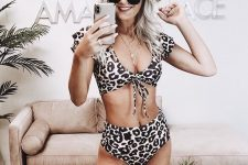 15 a girlish two piece swimsuit with a deep neckline top and a high waisted bottom
