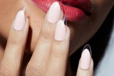 15 white oval nails with clear tips that look almost invisible is a bold and ultra-trendy option to go for