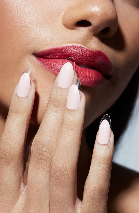 white oval nails with clear tips that look almost invisible is a bold and ultra trendy option to go for