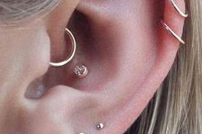 16 multiple piercings accented with minimalist gold studs and matching old hoop earrings