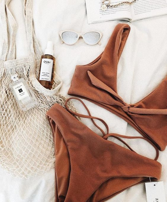 a chocolate brown textural bikini with a bow top and a bottom with straps