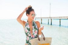 21 a bright tropical print one piece swimsuit with a plunging neckline is a bold and trendy idea