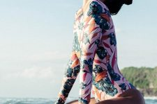 23 a pink long sleeve swimsuit with a bright tropical flower print is all fun