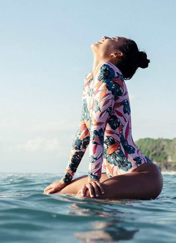 a pink long sleeve swimsuit with a bright tropical flower print is all fun