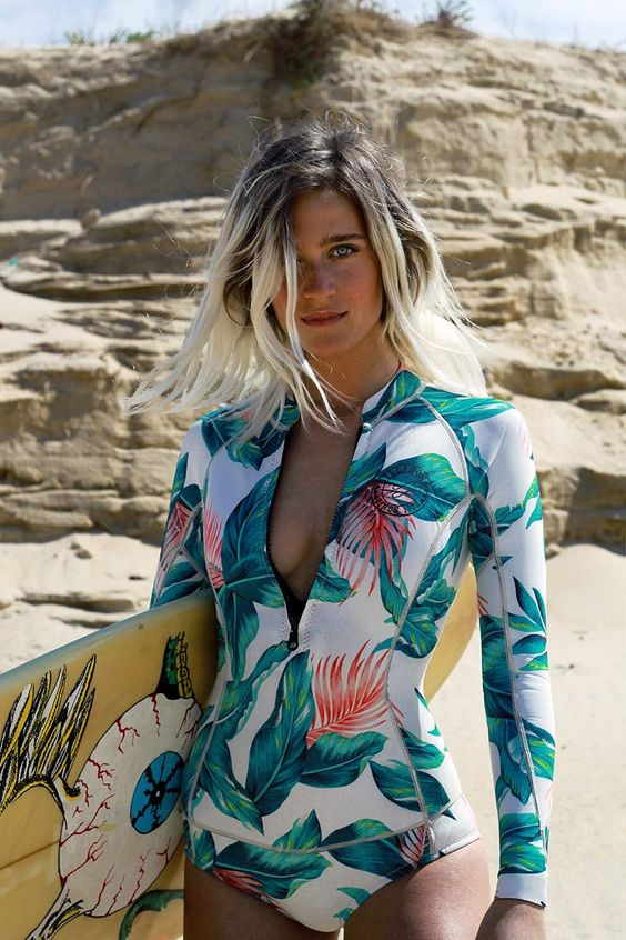 a surfer long sleeve swimsuit with a bright tropical print is a cool and bold idea