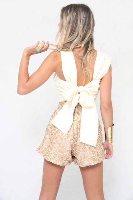 With beige high-waisted shorts