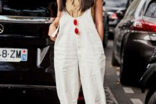 With beige shirt, white shoes and white loose jumpsuit