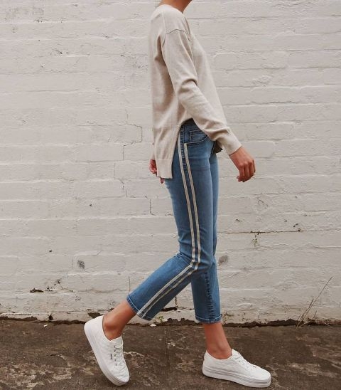 With beige sweatshirt and platform shoes