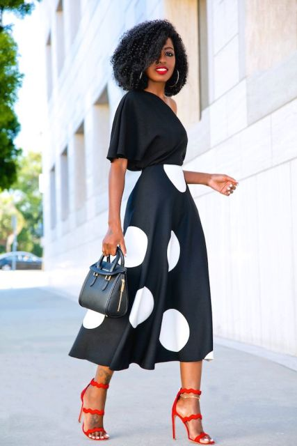 With black and white polka dot midi skirt, black bag and red ankle strap shoes