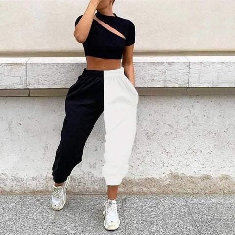 With black cutout crop top and white sneakers