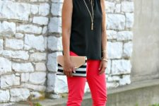 With black sleeveless top, red pants and beige heeled shoes