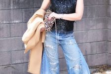 With black top, leopard bag and denim culottes