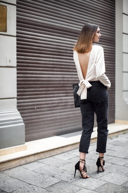 With black trousers, black clutch and lace up high heels