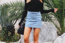 With black turtleneck, black bag and beige high heels