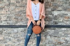 With button down shirt, peach loose cardigan, distressed jeans and brown rounded bag