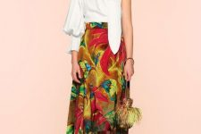 With colorful floral midi skirt, feather bag and red lace up high heels
