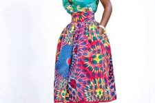With colorful printed midi skirt and beige high heels