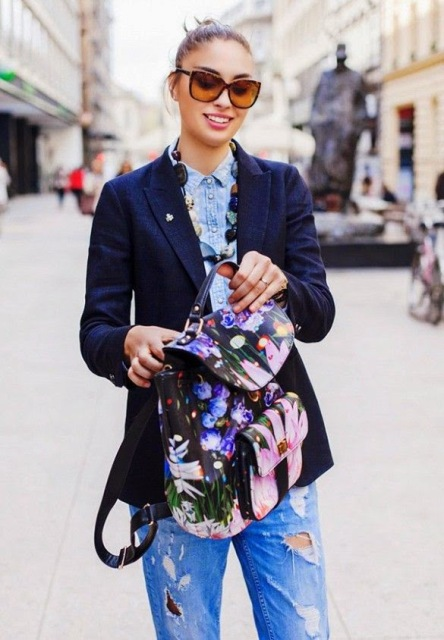 With denim shirt, navy blue blazer and distressed jeans
